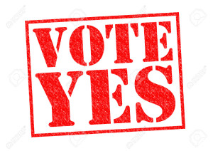 VOTE YES red Rubber Stamp over a white background.