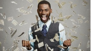 happy-man-pumping-fists-celebrates-success-under-money-rain-picture-id503957172-1024x576
